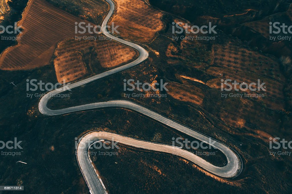 Winding road from above stock photo