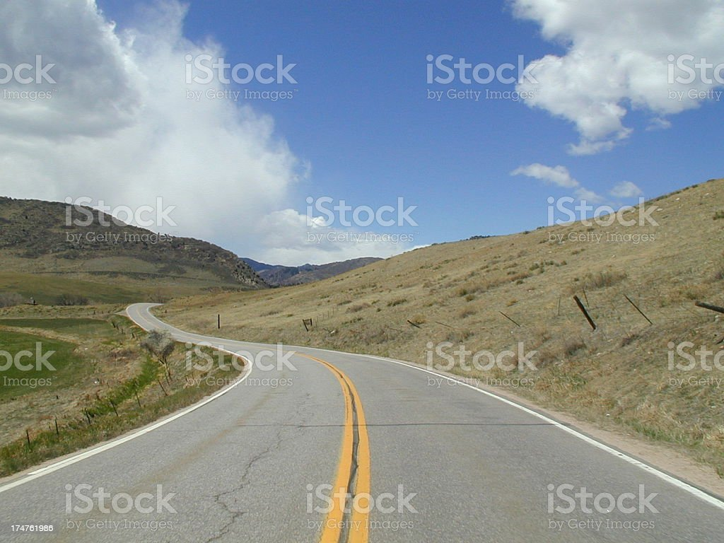 Winding Road Going Through The Country on Beautiful Day royalty-free stock photo