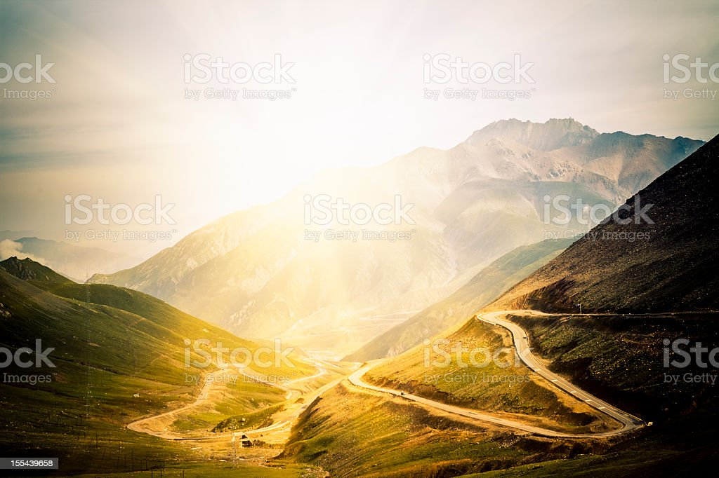 winding road in the mountain stock photo