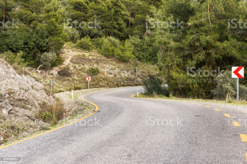 A winding road in the mountains stock photo