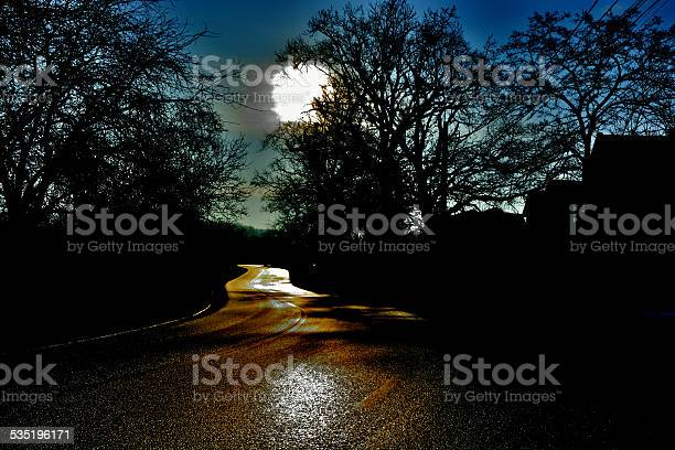 Photo of Winding road in the night uncertainty