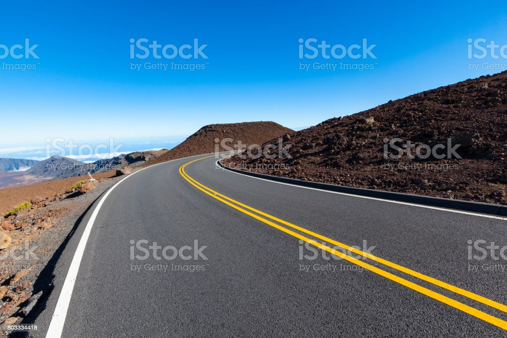 winding road into the clouds stock photo