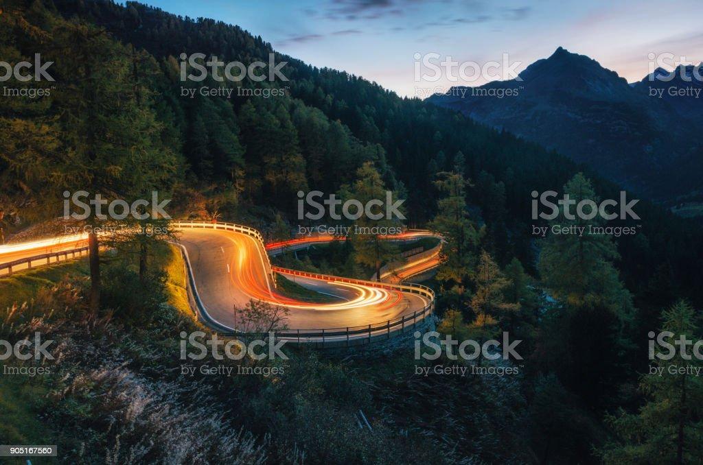 Winding road of Maloja Pass in Switzerland stock photo