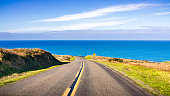 istock Winding road on the Pacific Ocean coastline on a clear sunny day, Point Reyes National Seashore, California 1200835920