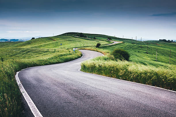 Winding Road Over Tuscany Hills stock photo
