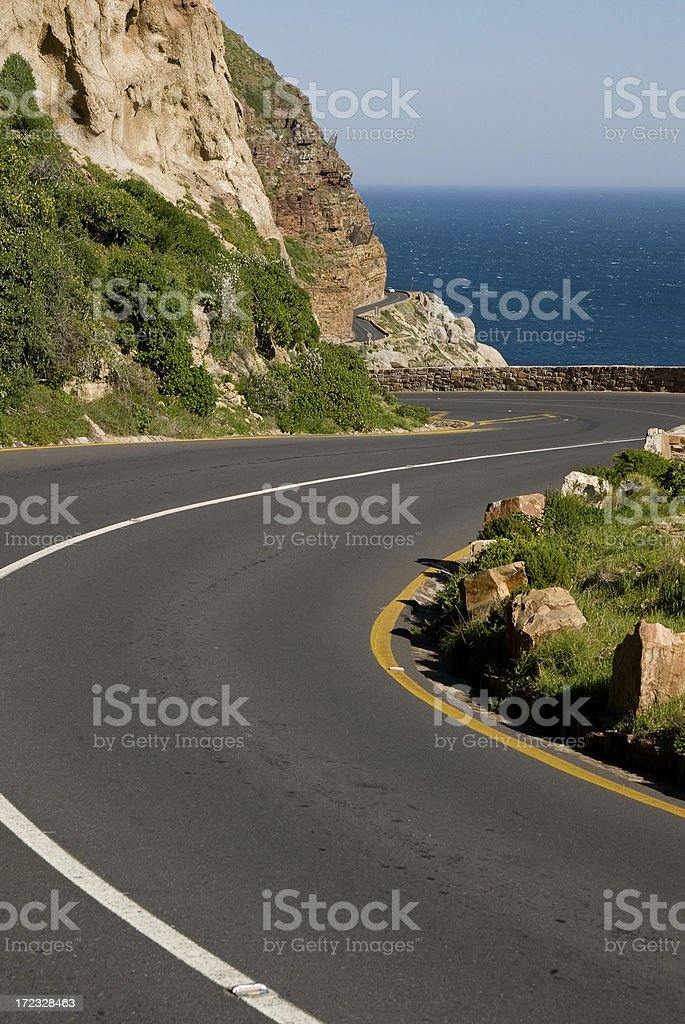 Winding road pass with sea and mountains royalty-free stock photo