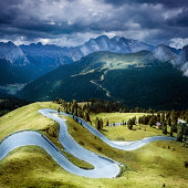 Asphalt winding road in a mountains. Dolomites. Italy.