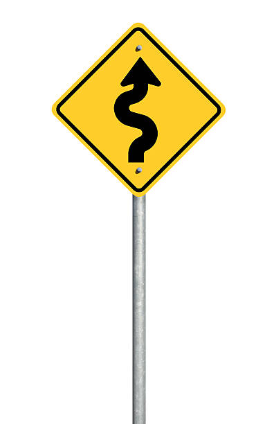winding road sign - road signs stock photos and pictures