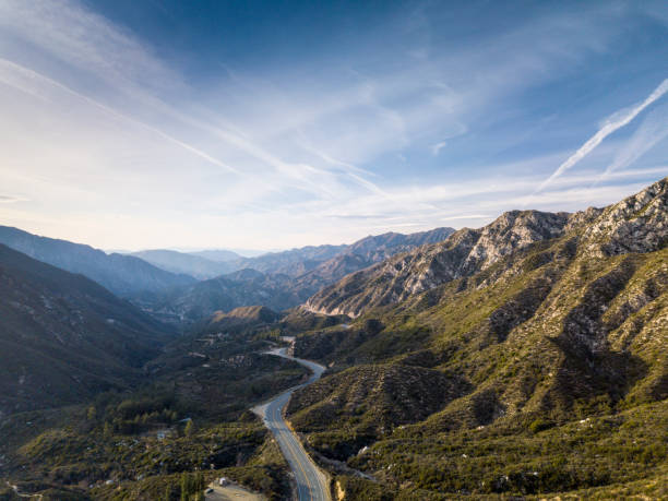 winding road through angeles crest mountains- aerial drone shot - san fernando valley stock photos and pictures
