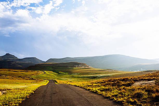 Winding road through the mountains stock photo