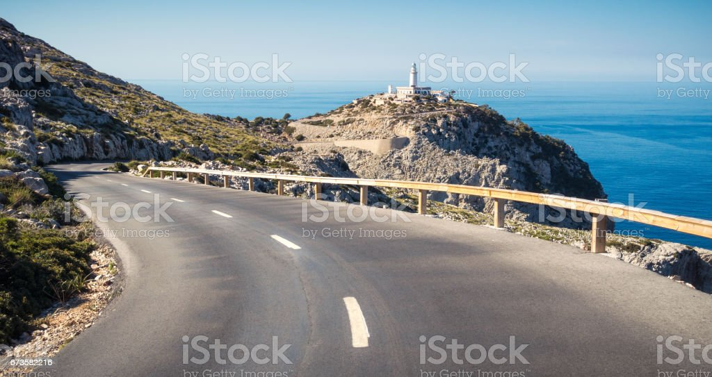 Winding road to Cap Formentor Lighthouse stock photo