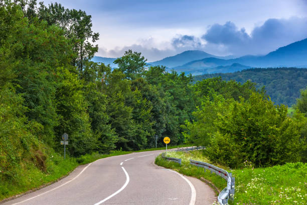 A winding road to the mountains in Valjevo, Serbia. stock photo
