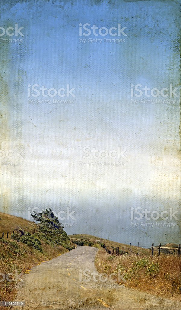 Winding Road to the Sea on Grunge background royalty-free stock photo