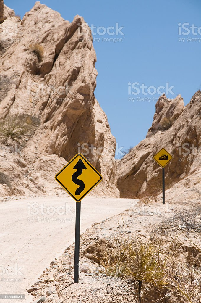 Winding steep mountain road with roadsigns ,  Argentina stock photo