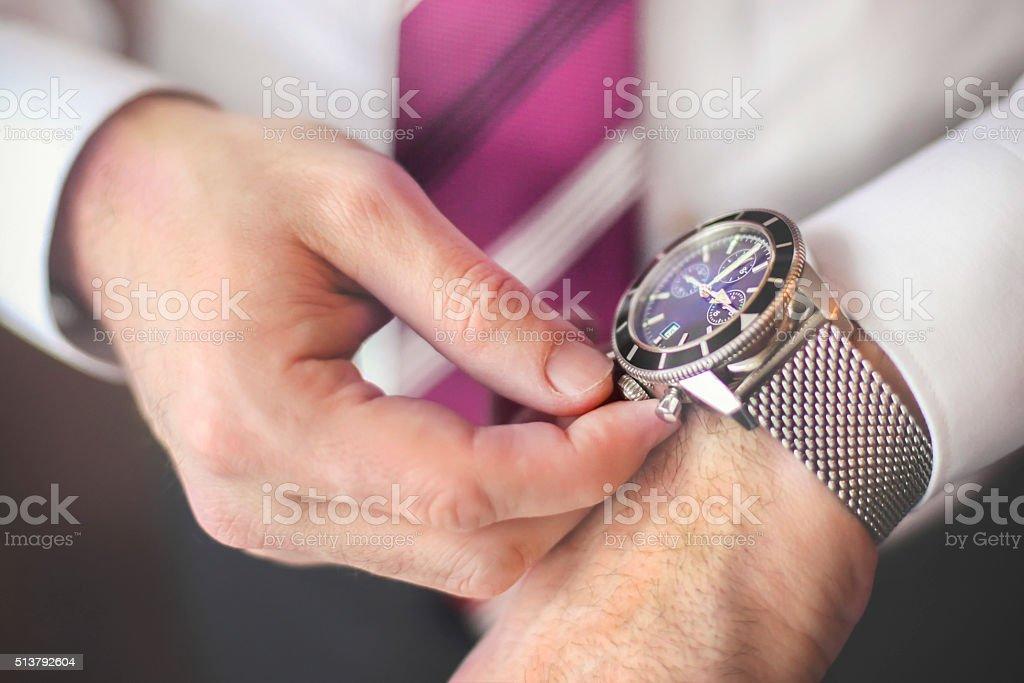 Winding up a wristwatch stock photo