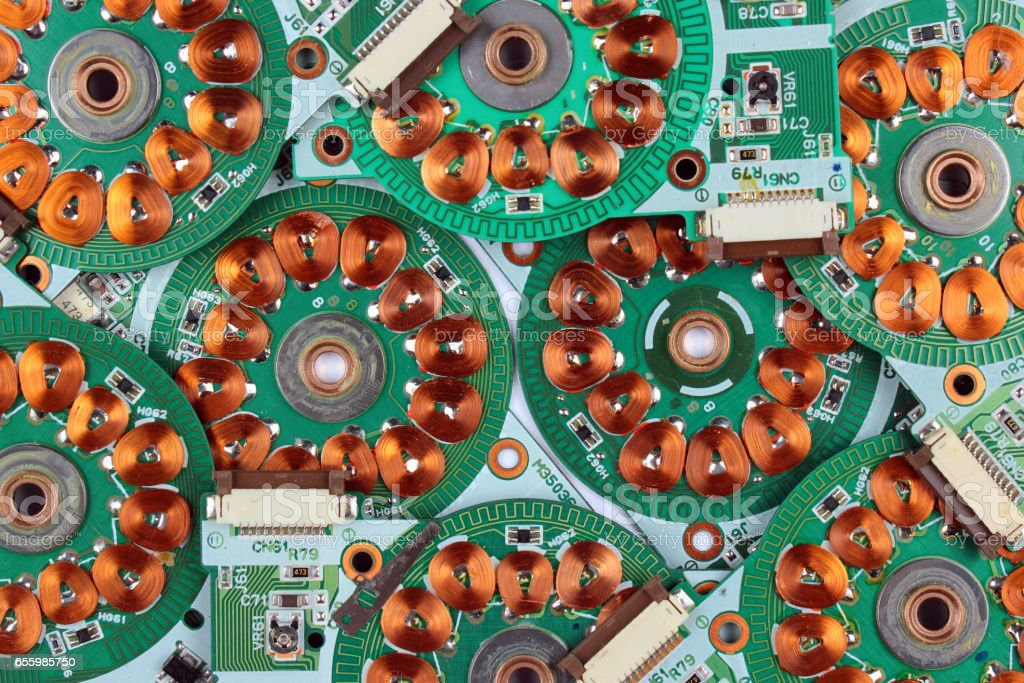 Windings and coils of brushless motors on printed boards stock photo
