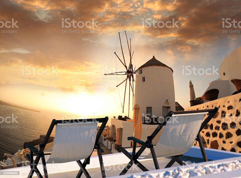 Windmill against colorful sunset, Santorini, Greece stock photo
