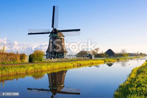 Dutch windmill along a canal