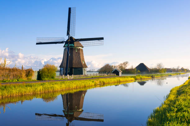 Windmill along a Canal stock photo