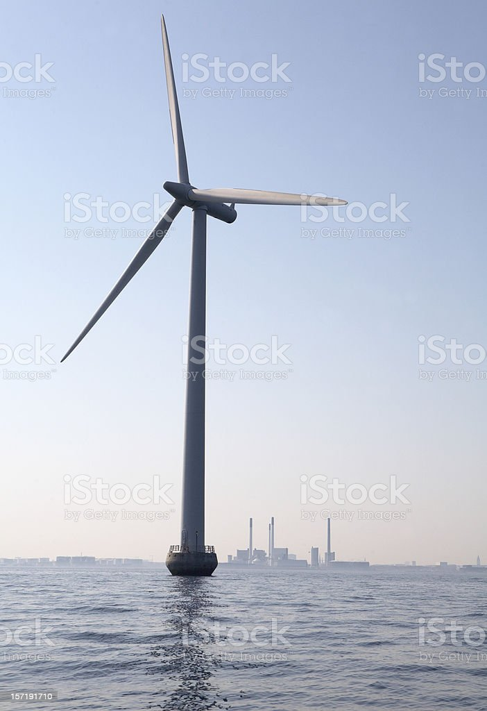 Windmill and coal plant stock photo