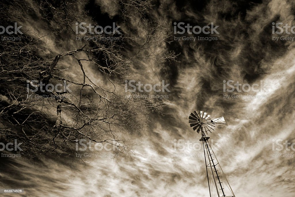 Windmill and Scary Sky stock photo
