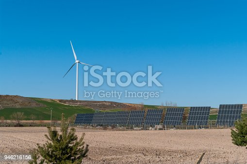 480763537 istock photo A windmill and solar panels - ecological and alternative energy generators 946216156