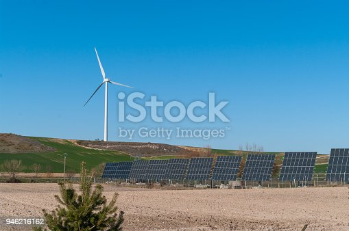 480763537 istock photo A windmill and solar panels - ecological and alternative energy generators 946216162
