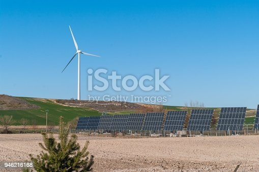 480763537 istock photo A windmill and solar panels - ecological and alternative energy generators 946216168