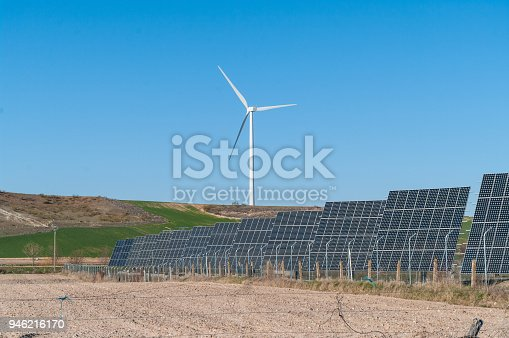 480763537 istock photo A windmill and solar panels - ecological and alternative energy generators 946216170