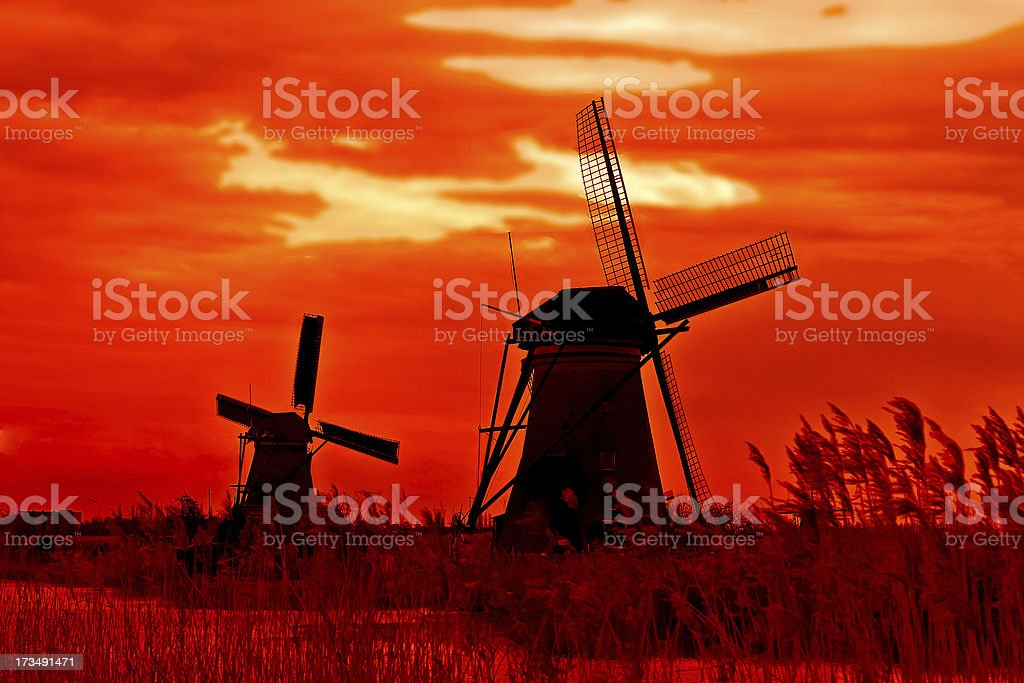 Windmill at sunset. Dutch landscape royalty-free stock photo