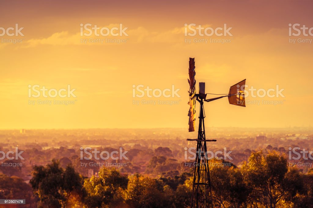 Windmill at sunset in South Australia stock photo