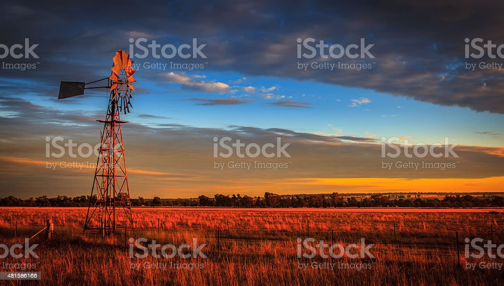 Windmill at Sunset, Outback Australia stock photo