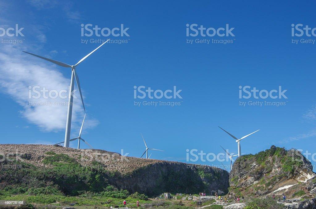 Windmill at the Kapurpurawan Rock Formation stock photo
