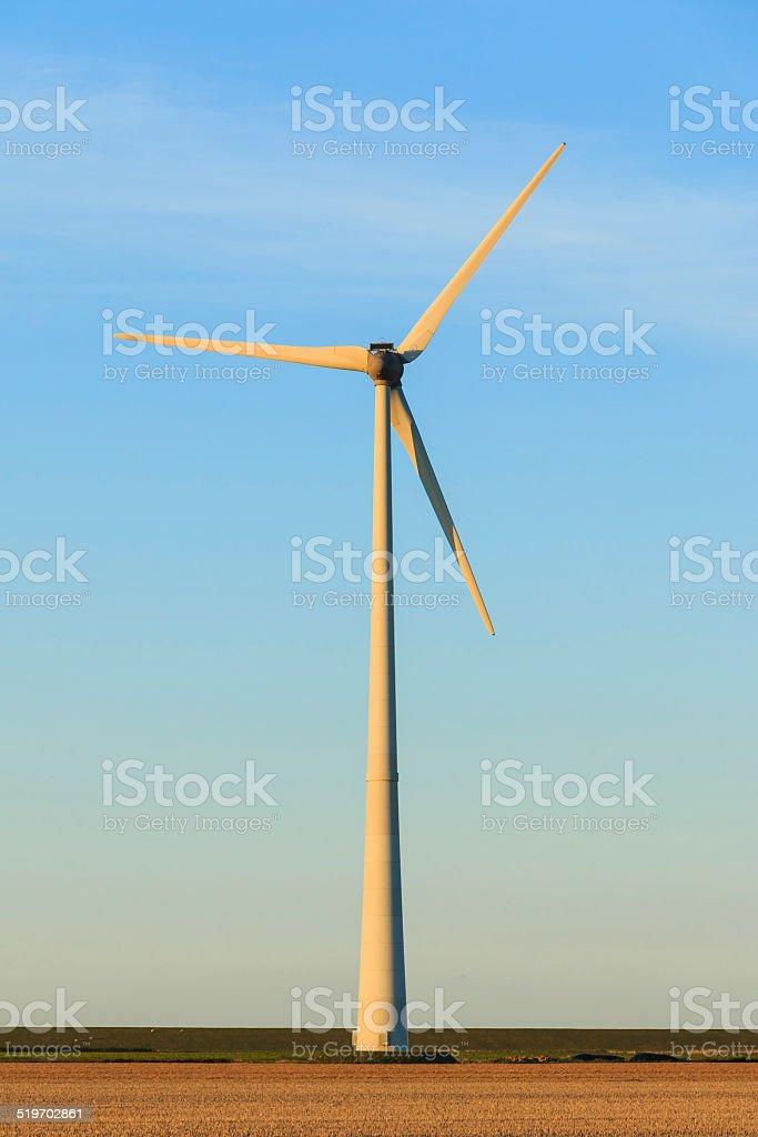Windmill close up at sunset stock photo