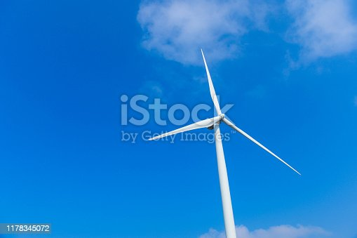 612720768 istock photo Windmill farm in the wind park , windmills isolated at sea on a beautiful bright day 1178345072