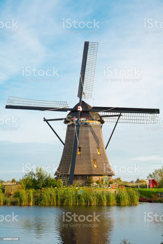 Windmill in Dutch water landscape, Kinderdijk, The Netherlands stock photo