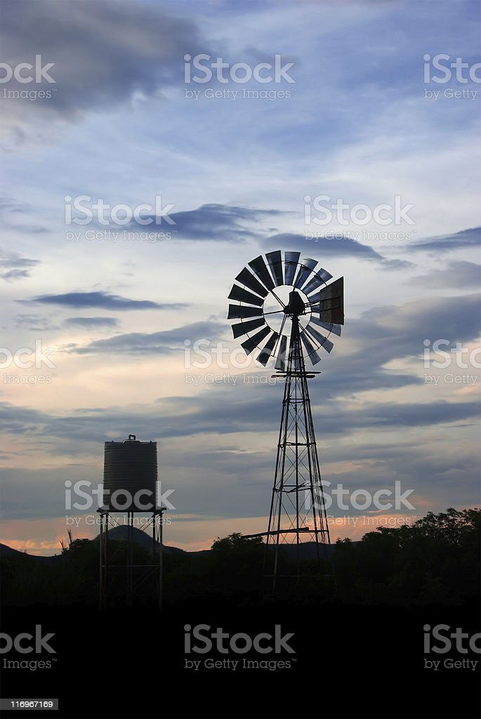 windmill in the evening sky stock photo