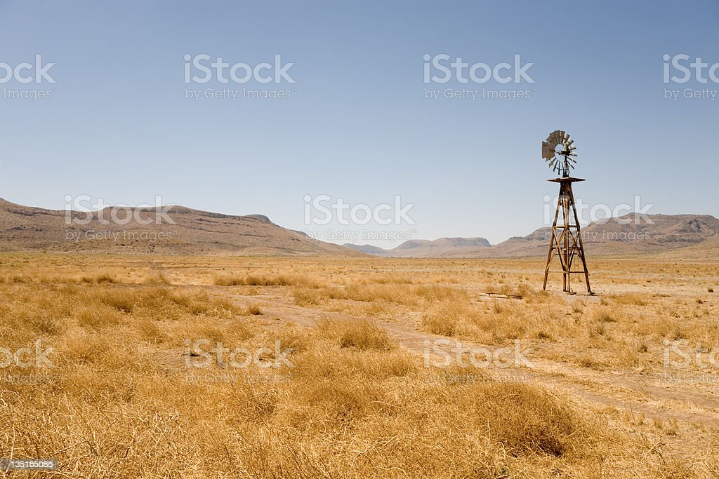 Windmill in the Texas Desert stock photo