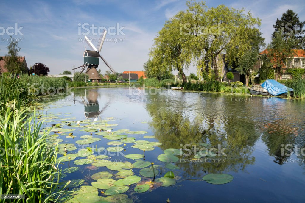 WIndmill on the Graafstroom river stock photo