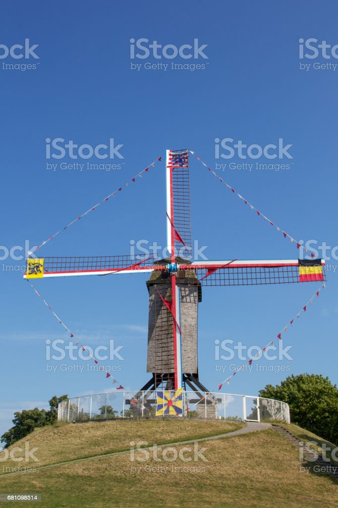 Windmill on top of green hill, Bruges, Belgium royalty-free stock photo