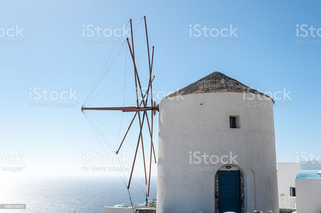 Windmill over the beautiful sea of Santorini foto royalty-free
