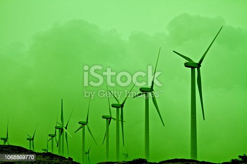 Abstract Green Windmills on hill