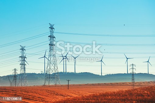 Windmill power generator on grassland, Electric Power Lines and Transmission Tower