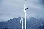 istock Windmill power generator on grassland 179350683