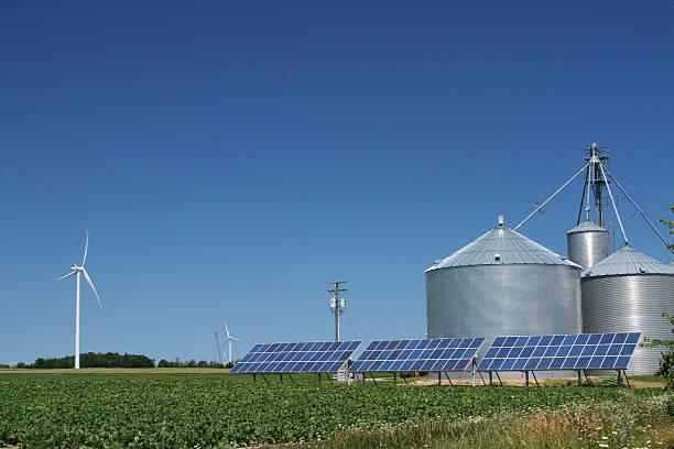 Windmill, solar panels, farm. Wind Turbine Electricity Power Generator. Michigan stock photo