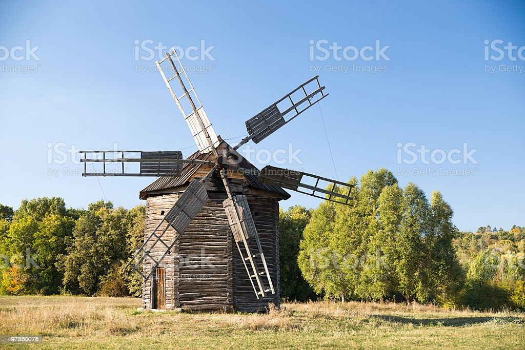Windmill standing in the field against the blue sky stock photo