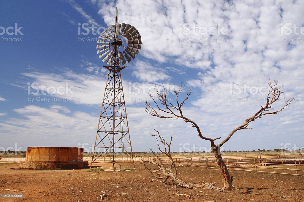Windmill water pump in Australian outback stock photo