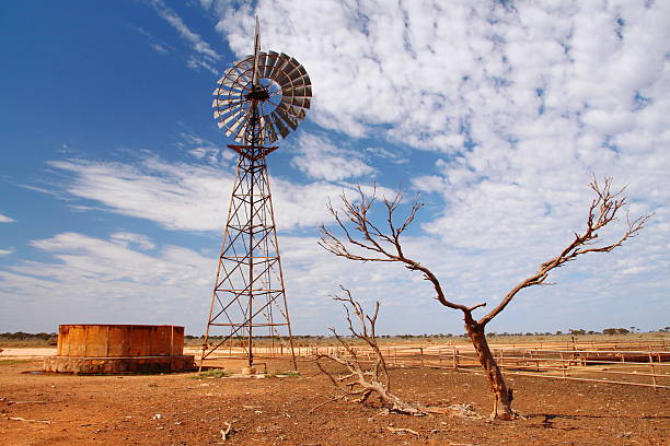 windmill water pump in australian outback - drought stock pictures, royalty-free photos & images
