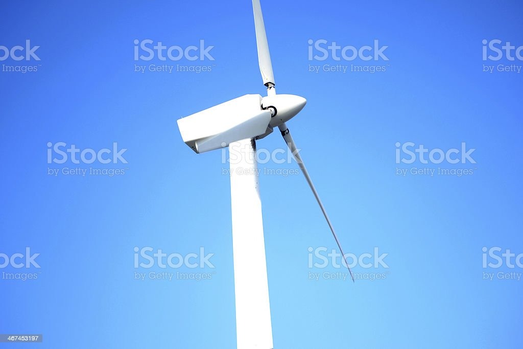 Windmill with blue sky background stock photo