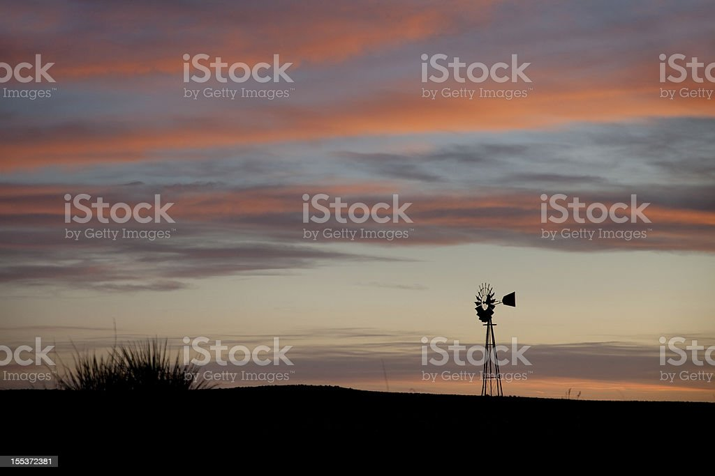 Windmill with Colorado sunset colors copy space horizontal royalty-free stock photo